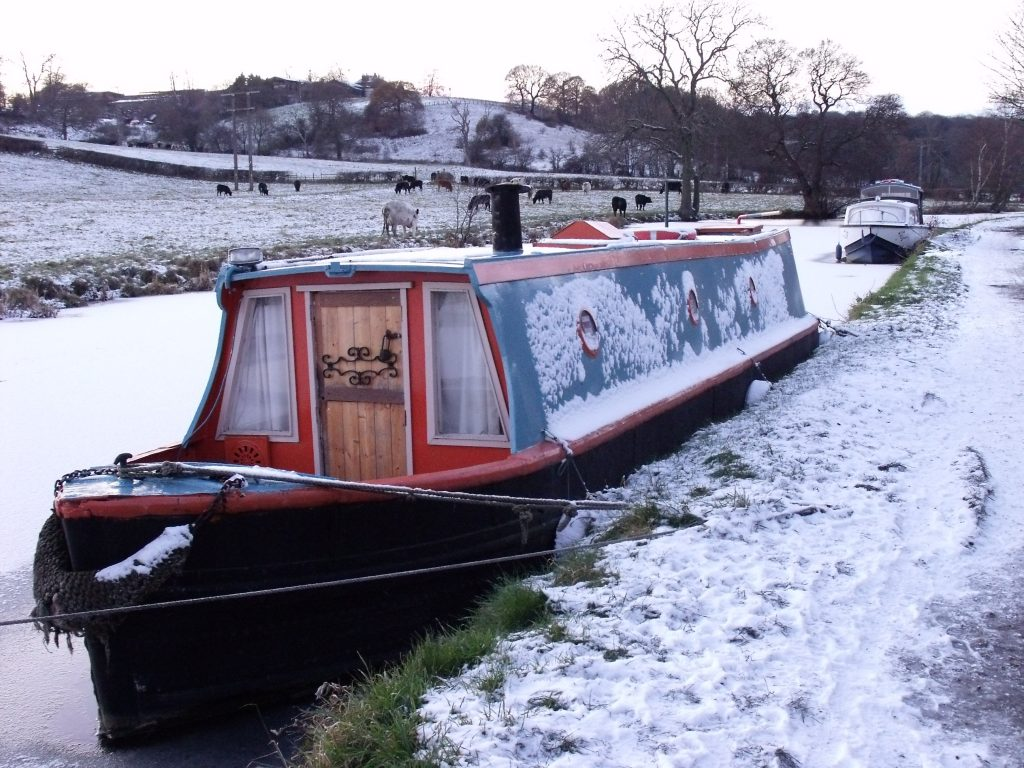Narrowboat in the frozen canal