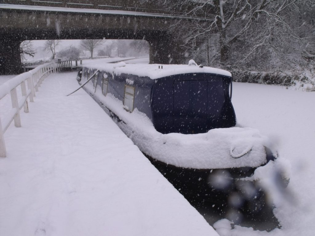Narrowboat Audrey Too in snow